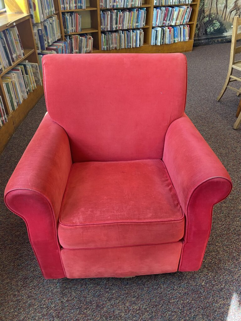 front view of plush red rocking chair