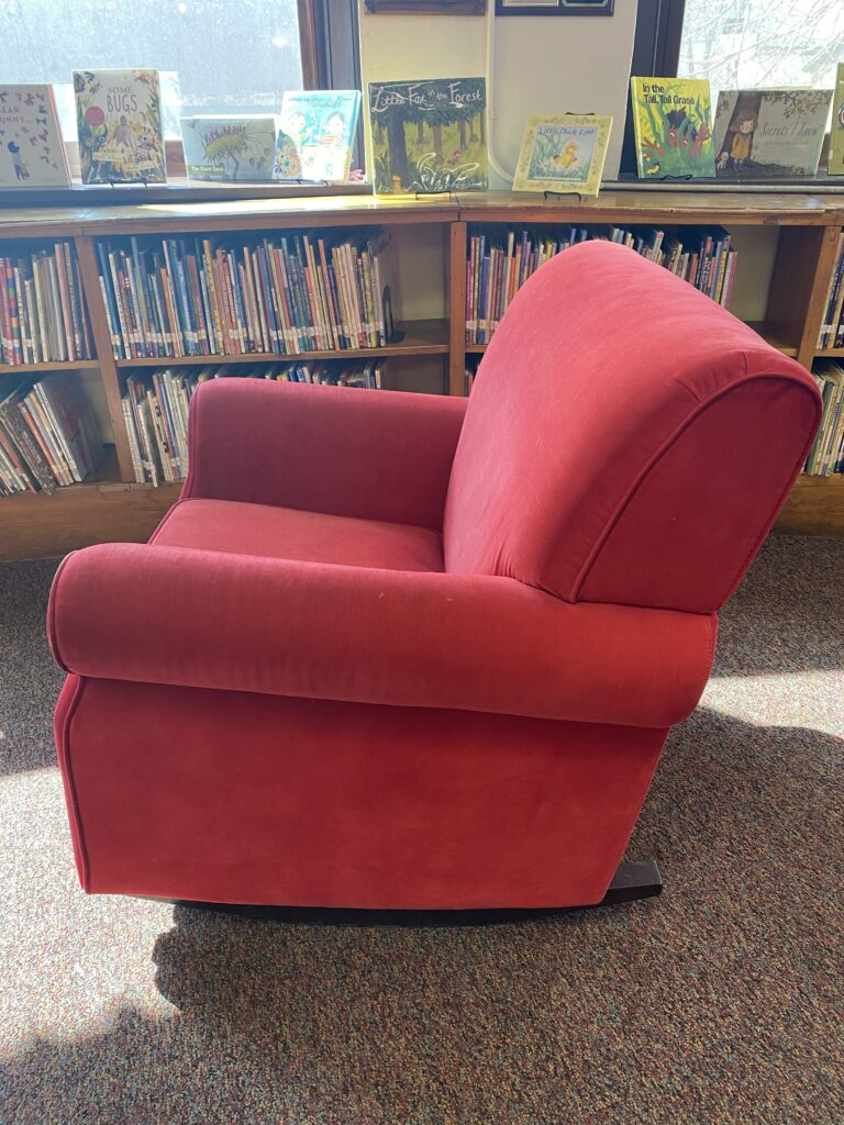 side view of plush red rocking chair